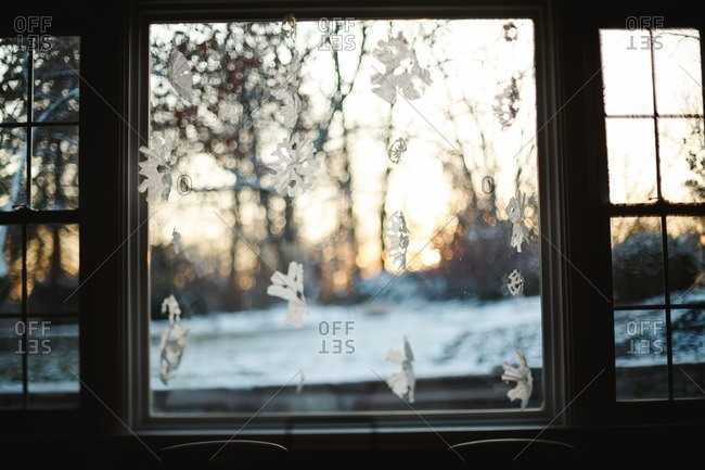 Paper snowflakes in window in morning