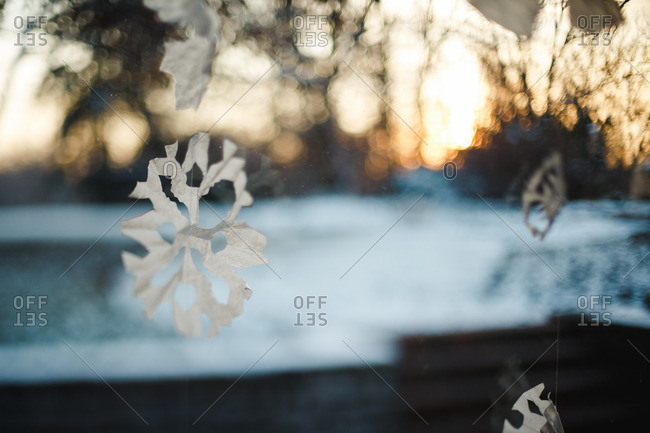 Paper snowflakes in morning window
