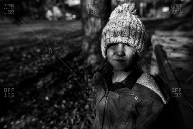 Girl in contrasting light with winter hat