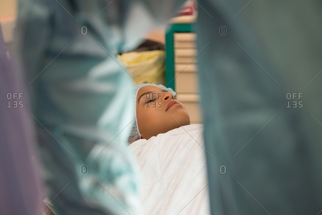 Female patient lying on a stretcher in an operating room