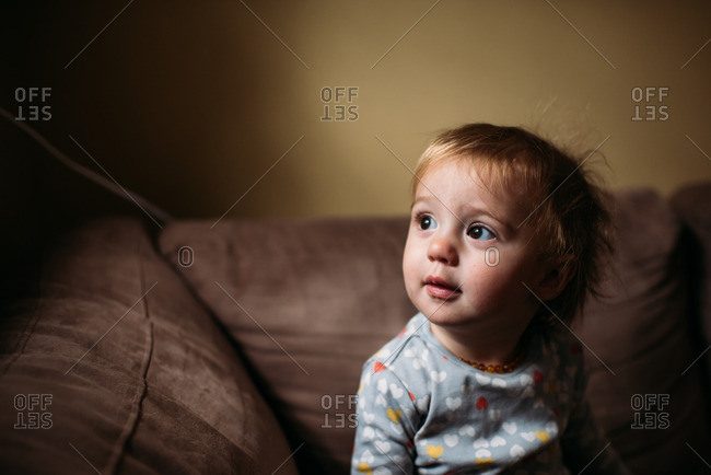 Toddler on couch in window light