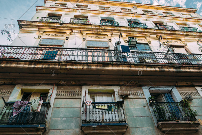 Upward view of apartment building with balconies in Cuba