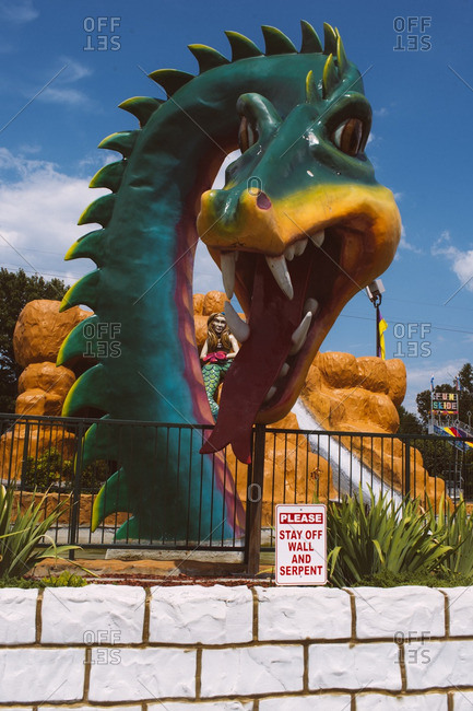 August 4, 2016: Serpent and mermaid attraction at an amusement park