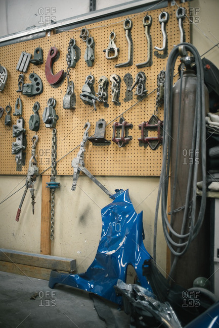 Tools and chains hanging on pegboard