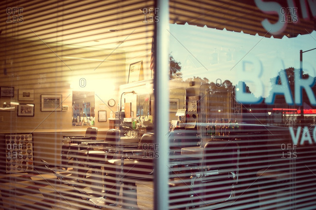 October 1, 2016: View through window of an empty barber shop