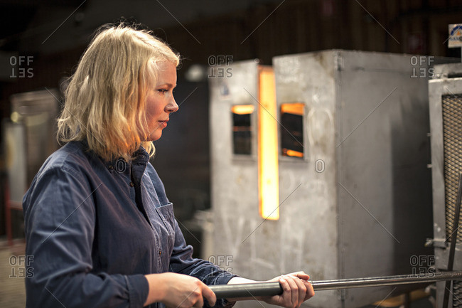 A female glass blower at work