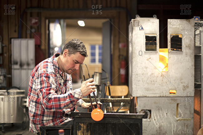 Man shaping hot glass