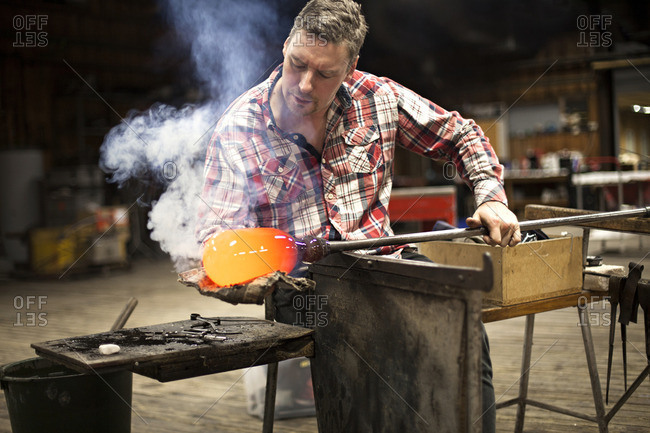 Man forming hot glass