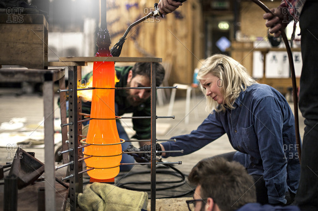 Glass makers shaping hot glass