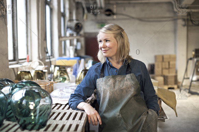 A female glass maker in workshop