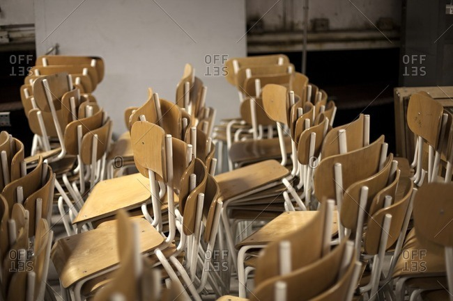Stacks of wood and metal chairs
