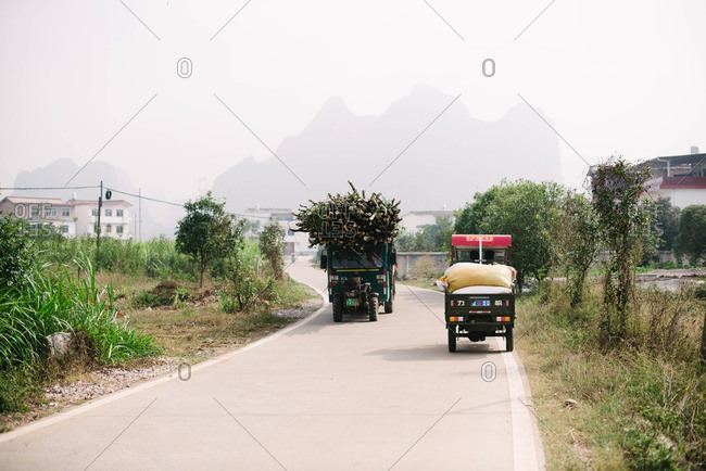 Guangxi, China - November 4, 2015: Delivery trucks on rural road
