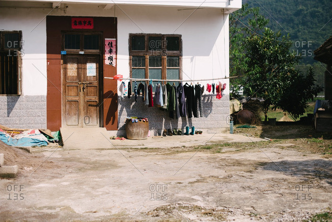 Guangxi, China - November 4, 2015: Laundry hanging by rural house