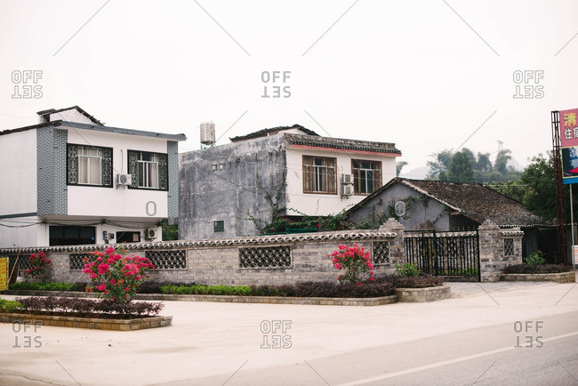 Guangxi, China - November 5, 2015: Gated houses in rural setting