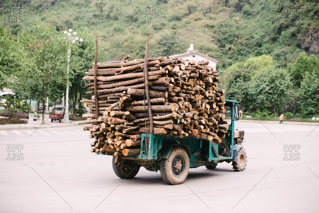 Guangxi, China - November 7, 2015: Truck delivering cut timber