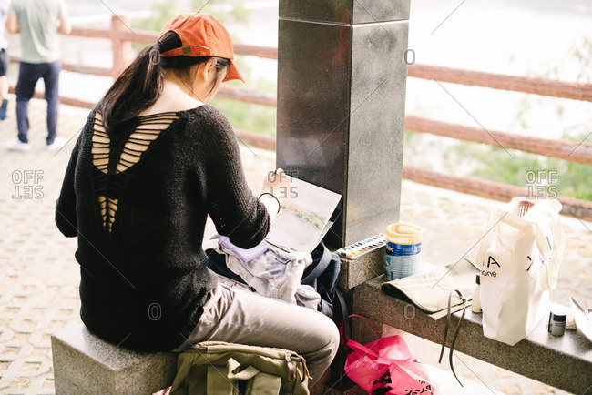 Guangdong Province, China - November 15, 2015: Woman painting in park