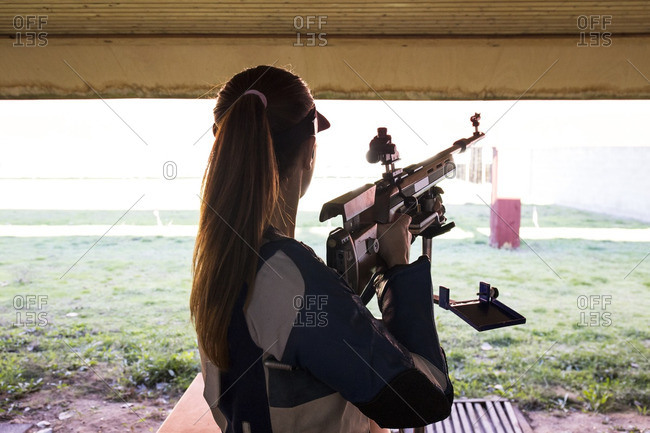 Woman in front of the targets in a shooting range