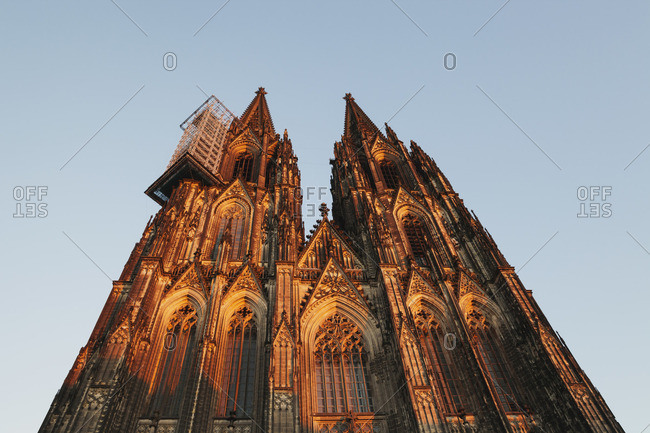 Germany- Cologne- view to Cologne Cathedral from below at sunset
