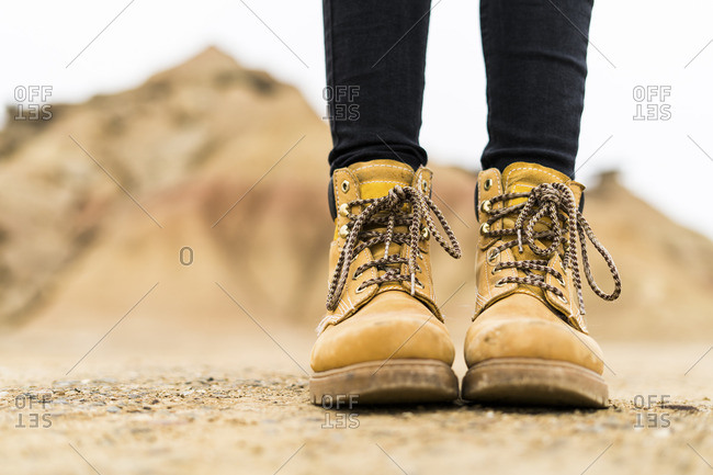 Spain- Navarra- Bardenas Reales- hiking shoes of young woman in nature park- close-up