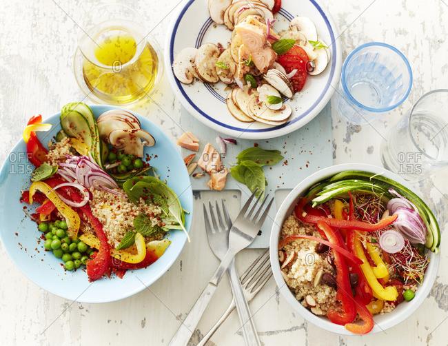 Three bowls of different salads