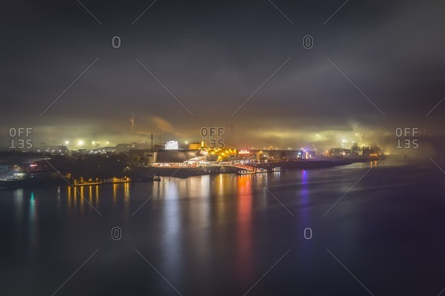 Germany- Hamburg- view to the harbor with lighted musical theater in the fog at night
