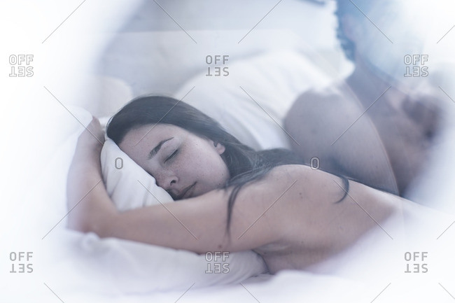 Portrait of sleeping woman with man in the background