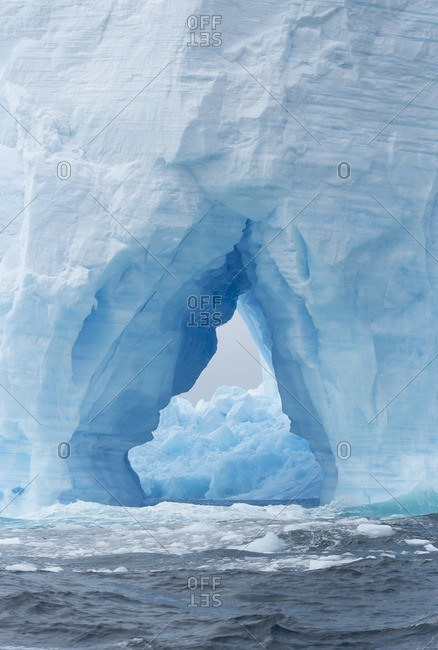 A natural arch formation inside a tabular iceberg