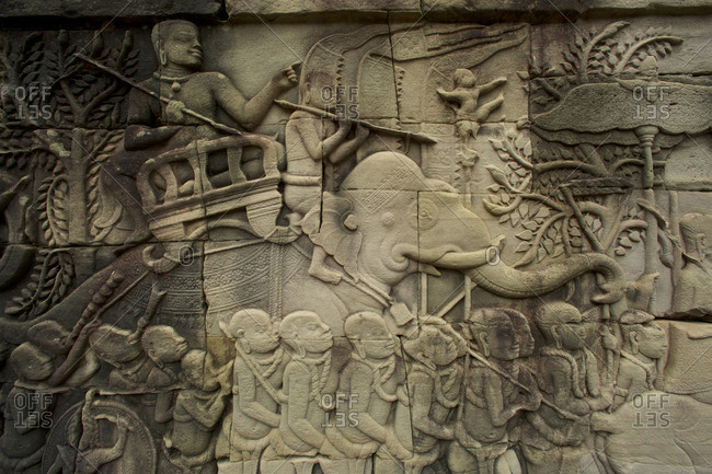 Relief carving with man on elephant at Angkor Thom Temple in Angkor Archaeological Park, Cambodia