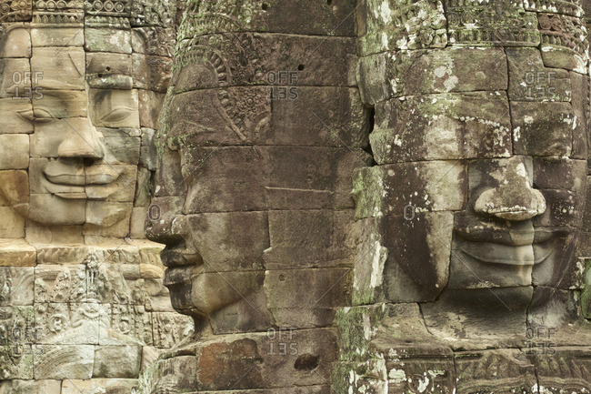 Massive smiling stone faces of Bayon Temple and the Angkor Thom Temple complex in Angkor Archaeological Park, Cambodia