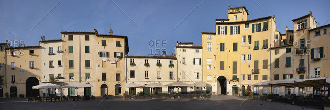 Buildings inside the Piazza Anfiteatro which was built inside a Roman amphitheater, Lucca, Italy