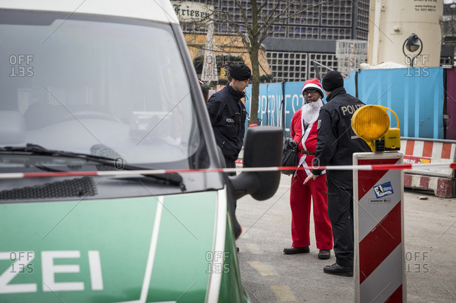 Berlin, Germany - December 20, 2016: Police talk to a Santa Claus the day after the terrorist attack in Berlin, Germany, on the 19th of December 2016