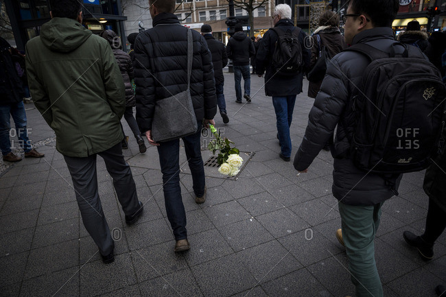 Berlin, Germany - December 20, 2016: A man on his way to lay flowers at a memorial the day after the terrorist attack in Berlin, Germany, on the 19th of December 2016