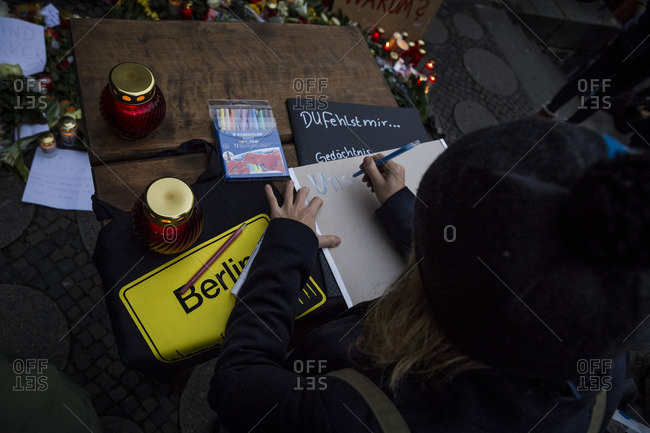 Berlin, Germany - December 20, 2016: A woman signs a message book the day after the terrorist attack in Berlin, Germany, on the 19th of December 2016