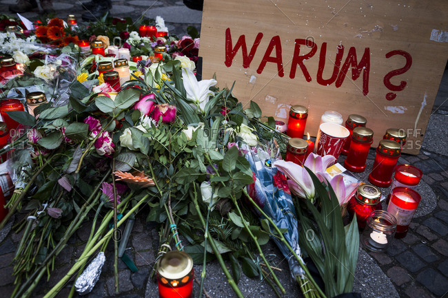 Berlin, Germany - December 20, 2016: Flowers, messages and candles at a street memorial the day after the terrorist attack in Berlin, Germany, on the 19th of December 2016