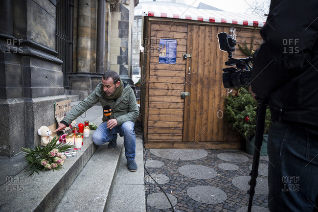 Berlin, Germany - December 20, 2016: A TV presenter makes a report on the day after the terrorist attack in Berlin, Germany, on the 19th of December 2016