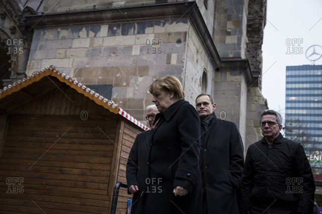 Berlin, Germany - December 20, 2016: Chancellor Angela Merkel, Berlin Mayor Michael Muller and other politicians visit the site on the day after the terrorist attack in Berlin, Germany, on the 19th of December 2016