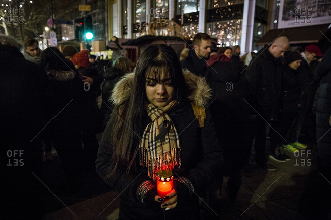 Berlin, Germany - December 20, 2016: A woman cries during a memorial service the day after the terrorist attack in Berlin, Germany, on the 19th of December 2016