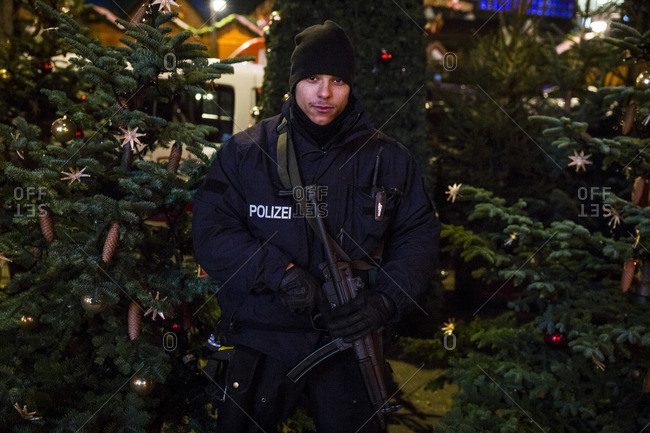 Berlin, Germany - December 20, 2016: A policeman guards the street the day after the terrorist attack in Berlin, Germany, on the 19th of December 2016