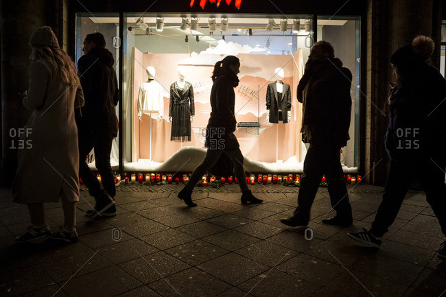 Berlin, Germany - December 20, 2016: Pedestrians walk past a memorial on the day after the terrorist attack in Berlin, Germany, on the 19th of December 2016
