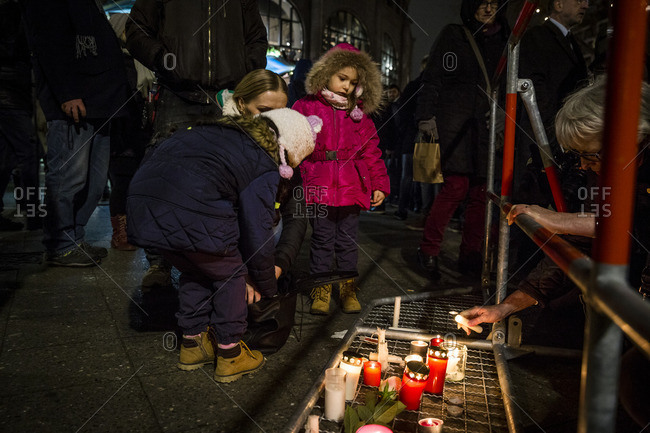 Berlin, Germany - December 20, 2016: Children by a memorial the day after the terrorist attack in Berlin, Germany, on the 19th of December 2016