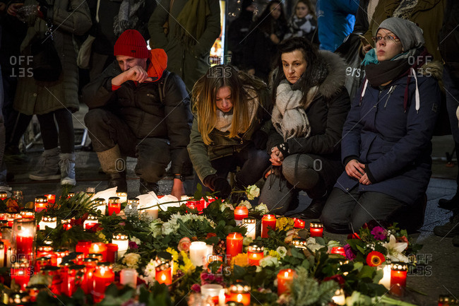 Berlin, Germany - December 20, 2016: People gather to pay their respects at a memorial the day after the terrorist attack in Berlin, Germany, on the 19th of December 2016