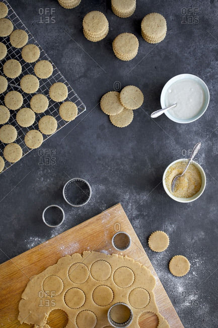 Shortbread Cookie process. Photographed from top view on black/gray background.