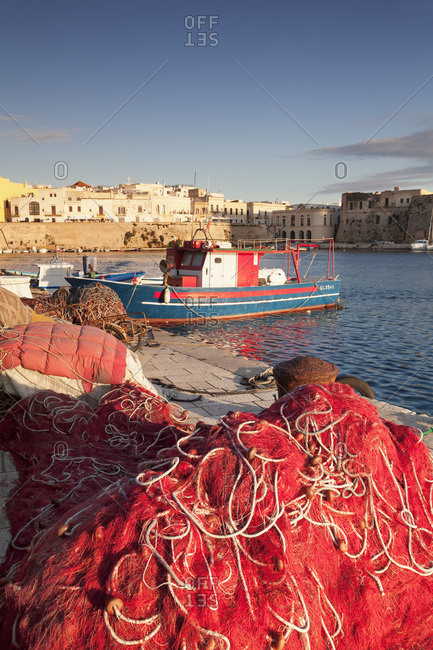 Lecce, Italy - May 18, 2016: Fishing boats and fishing net at the port, old town, Gallipoli, Lecce province, Salentine Peninsula, Puglia, Italy, Mediterranean, Europe