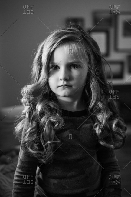 Black and white portrait of a little girl with curly hair