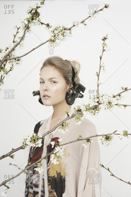 London, England - April 5, 2016: Girl behind cherry blossom