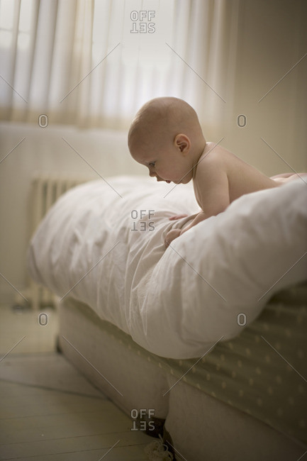 Baby boy lying on a bed