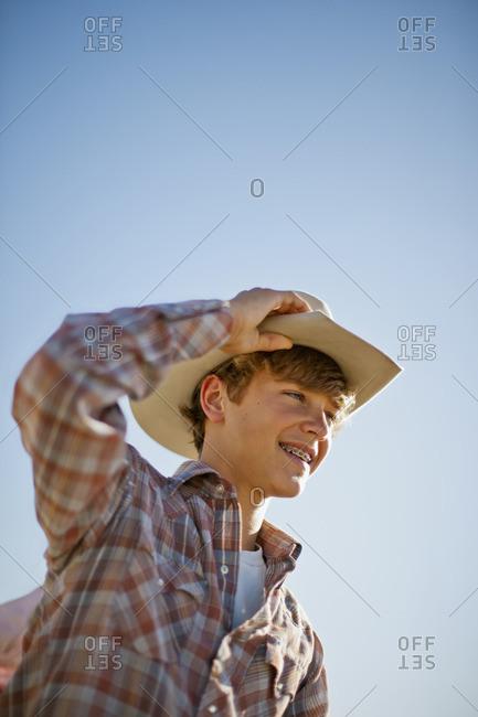 Teenage boy wearing a cowboy hat
