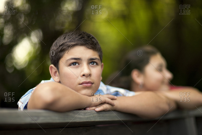 Young boy looking out from a lookout deck