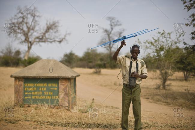 Park ranger using an antenna