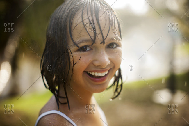 Smiling young girl with wet hair
